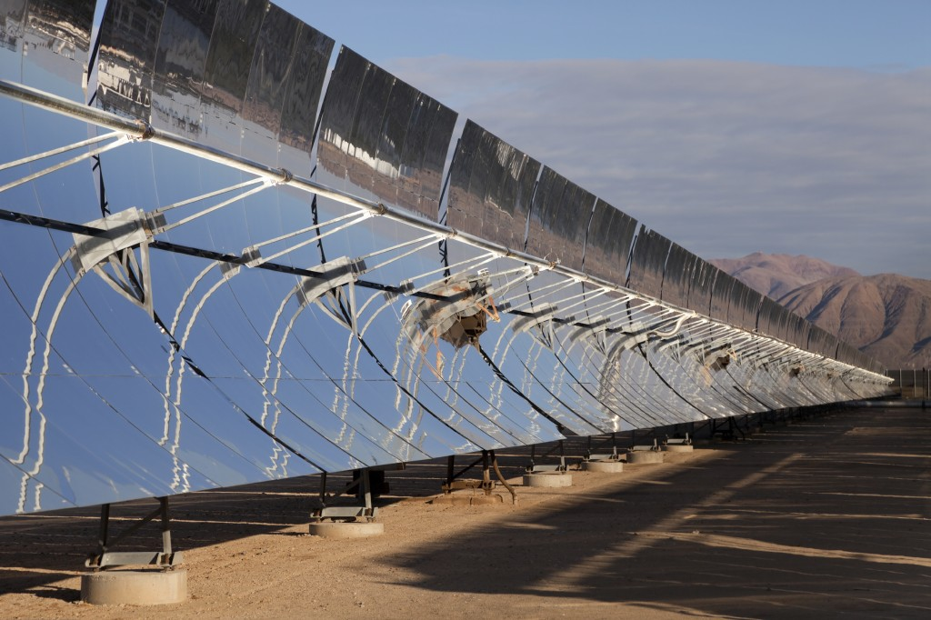 Solar power reflectors line the desert in a renewable energy plant